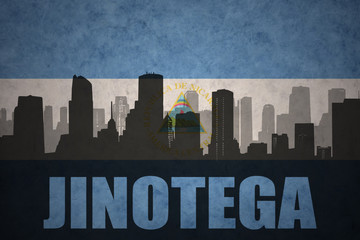 abstract silhouette of the city with text Jinotega at the vintage nicaraguan flag
