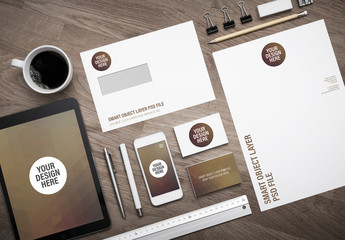 Smartphone and Stationery on Wooden Desk Mockup 1