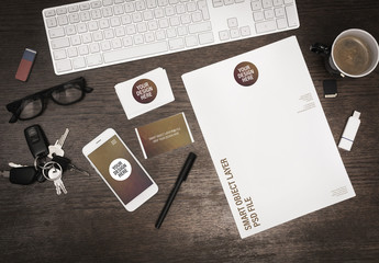Smartphone and Stationery on Wooden Desk Mockup 3