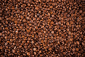 Coffee beans texture closeup. Brown coffee, background texture, closeup. Nice background for your ideas.