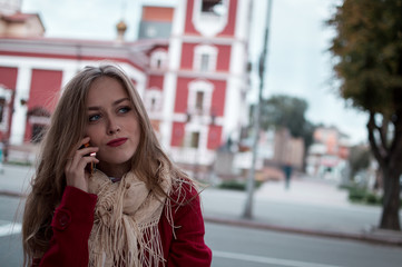 portrait of beautiful girl with blue eyes in red