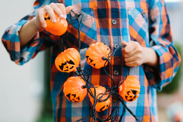 Boy making Halloween decoration.