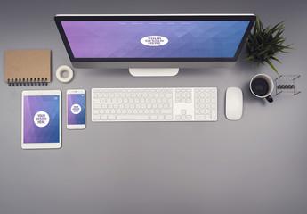 Desktop Computer and Smartphone on a Gray Desk Mockup 2