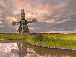 Spoed Fotobehang Molens Wooden windmill