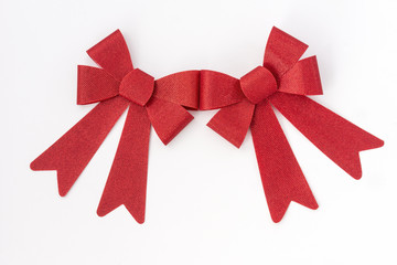 Two shiny red holiday bows