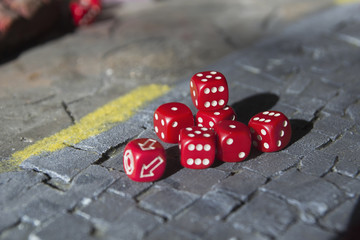 a lot of red dice on a craps table
