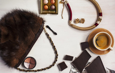 Women's set of fashion accessories in brown and golden colors on