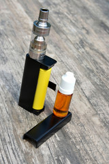 Electronic cigarettes and bottles of liquid.