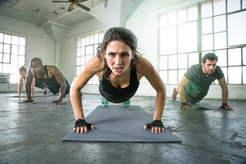 Athletic group of fit multi ethnic people exercising with vigor vitality passion