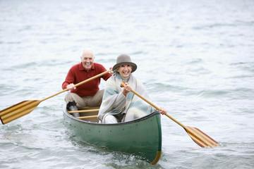Germany, Bavaria, Walchensee, Senior couple rowing boat on lake