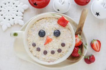 Snowman porridge oatmeal breakfast , Fun Christmas food art for kids
