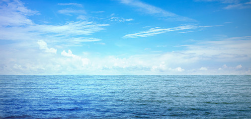 Blue sea/ocean and clouds sky abstract background in Thailand. horizon over view. summer relaxing time.