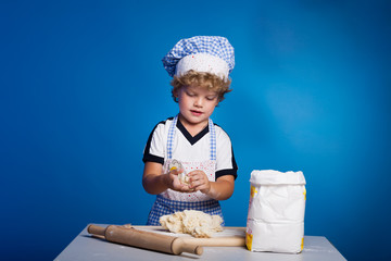 Little boy chef with flour dough and prepare pizza
