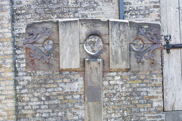 Old wooden pillory close up