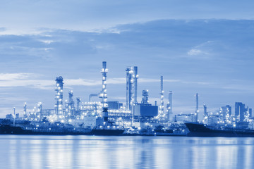 Twilight of the oil refinery plant, Oil refinery blue tone.