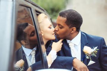 Happy newlyweds kiss