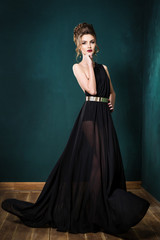 Beautiful young girl in a black dress