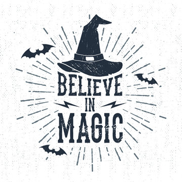 """Hand drawn Halloween label with textured witch hat vector illustration and """"Believe in magic"""" lettering."""