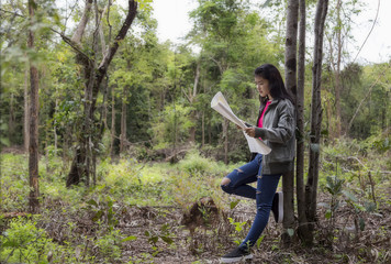Girl frienship traveling in the woods, Map in hand, and get dire