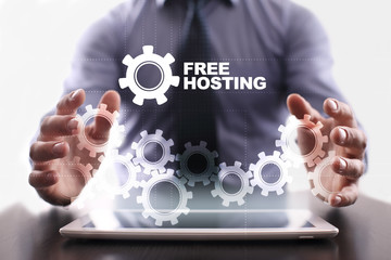 Businessman is using tablet pc and selecting free hosting