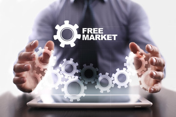 Businessman is using tablet pc and selecting free market