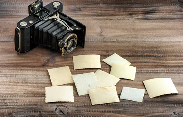 Vintage photo camera and old paper photos