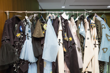 many designer clothes prepared for hanging on display trempel