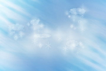 Grain background winter idyll with clouds and snow flakes lit by rays