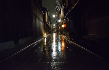 Kyoto street during a rainy night (Gion district). Wall mural