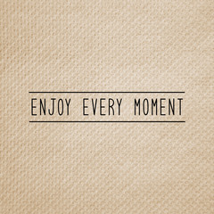 Enjoy every moment on brown tissue paper