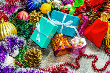 New year picture. Gifts boxes, Christmas decorations, tinsel and