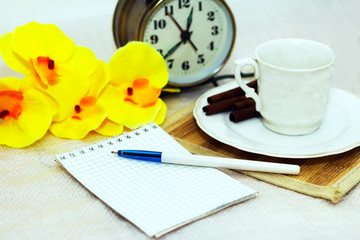 Coffee Cup, Notepad, Orchid on the table