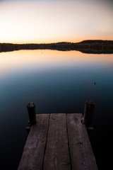 Pier on a lake at sunset