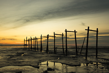 wooden structure over beautiful light during sunset and low tide