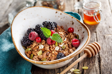 Homemade granola with blackberry and honey.