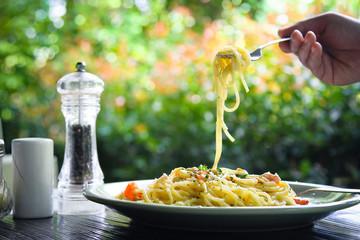 Pasta with mushrooms, smoked sausage and cream sauce with basil