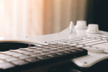 closeup picture of electric rock guitar , film and grunge style