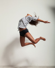 young beautiful dancer jump in a studio
