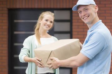 Courier delivering a parcel to customer