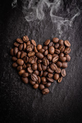 roasted coffee beans on dark background, can be used as a background