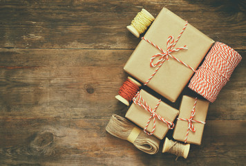 handmade gift boxes over wooden background