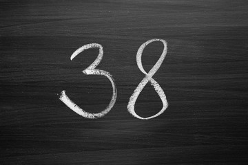 number thirty eight enumeration written with a chalk on the blackboard