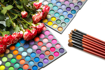 Rose flowers and palettes with eyeshadows