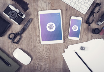 Tablet and Smartphone Close Up on Wooden Desk with Camera and Drawing Paper Mockup 1