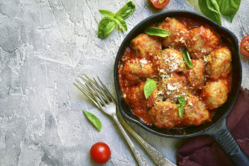 Meatballs in tomato sauce in a skillet.Top view.