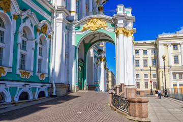 Historic entrance with white columns in Hermitage palace in Saint Petersburg, Russia.