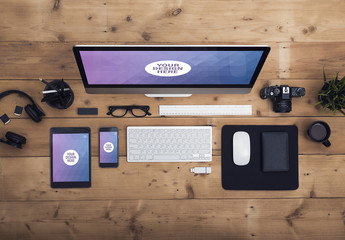 Desktop Computer, Tablet, and Smartphone on a Wooden Table with Creative Tools Mockup 1