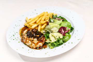 meat with french fries and salad