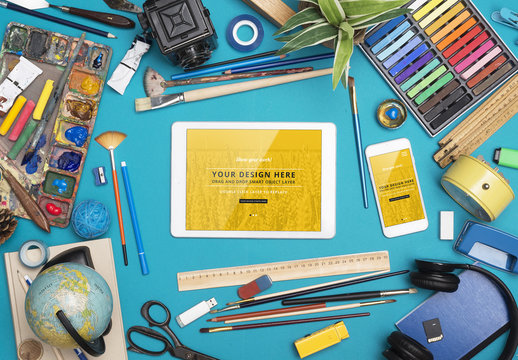 Tablet and Smartphone with Assorted Art Supplies on Blue Background Mockup