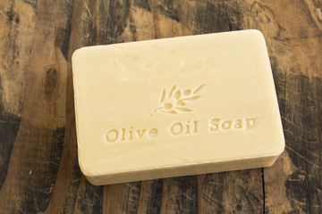 Olive Oil Soap on Rustic Wooden Background